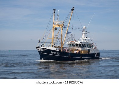 DEN OEVER, THE NETHERLANDS – AUGUSTUS 28, 2018: Fishing day event a Netherlands festival  for promoting the fishing industry on the waddensea