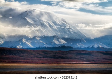 Denali (formerly Mt McKinley) rises miles above the vast low tundra near Kantishna, Alaska