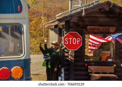 Denali National Park, Alaska, August 29, 2016:  The National Park Service commemorates its 100th anniversary.  Here park rangers greet a tour bus at the entrance to Denali National Park, August, 2016.