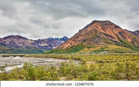 Denali National Park and Preserve, AK - Aug 21, 2018: A view of the Park Road and Teklanika River Bridge in Denali National Park and Preserve Alaska