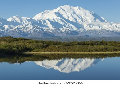 Denali reflected in a kettle pond, Denali National Park, Alaska.
