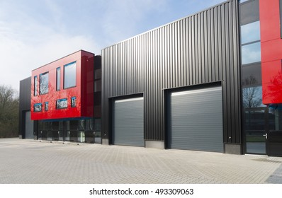 DENEKAMP, NETHERLANDS - FEBRUARY 13, 2016: Modern exterior of a newly build industrial building with red office units
