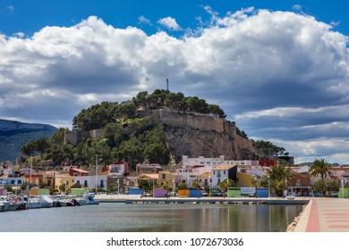 DENIA, SPAIN - APRIL 12TH 2018: A beautiful view of Castillo de Denia from Port Denia in Spain, on 12th April 2018.
