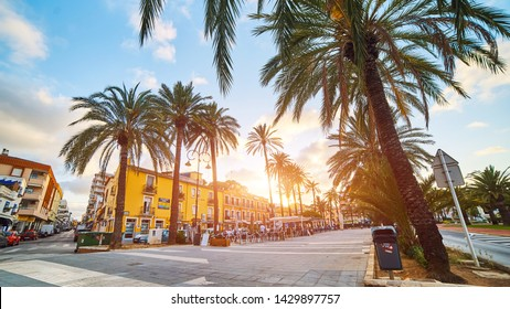 DENIA, SPAIN - JUNE 13, 2019: Old town of Denia with narrow streets, colorful buildings and pavement at sunset. Beautiful Spanish town on Costa Blanca.