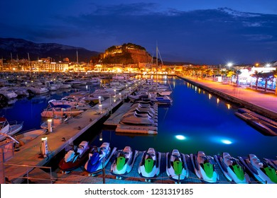 Denia sunset with castle and marina at Alicante in Spain