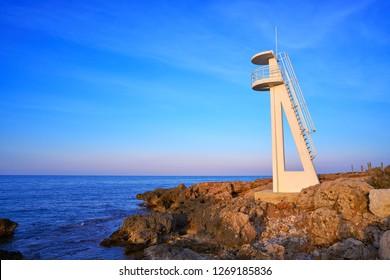 Denia sunset in Las Rotas beach el Trampoli baywatch tower Alicante of Spain