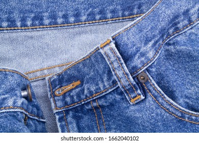 Denim blue jeans close up, zipper and pockets of jeans as fashion background