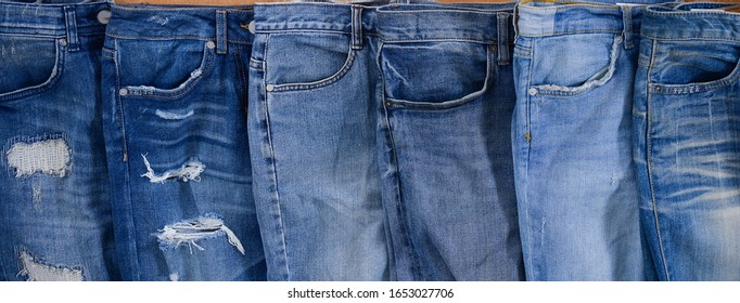 denim blue jeans design detail with front pocket with seams on wooden background