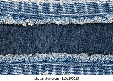 Denim blue jeans fabric frame. Bleached denim fabric with fringe edge on blue denim background, text place, copy space. Worn Jeans Casual Double Color patch