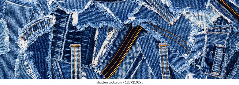 Denim blue jeans fabric frame. Ripped denim fabric , text place, copy space.   Destroyed torn denim blue jeans patches, banner background