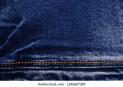 Denim. Blue jeans. Textile denim background. Selective focus.