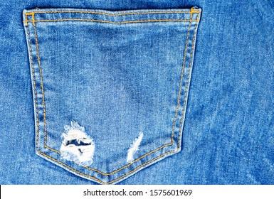 Denim blue jeans trouser pants back pocket detail closeup texture Top view , copyscape .