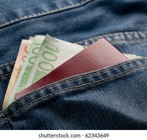 Denim detail with money and passport