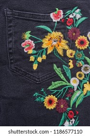 denim embroidered floral pattern jeans-pocket view texture