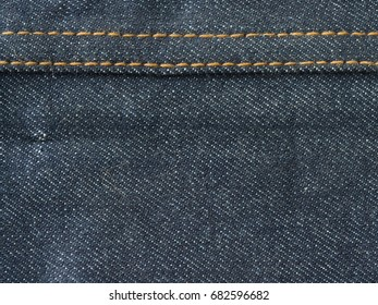 Denim fabric and stitching seams.