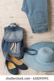 Denim fashion set - clothes, shoes and accessories. Selective focus.