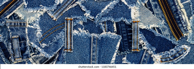 Denim jeans background. Destroyed torn denim blue jeans patches, banner fashion background