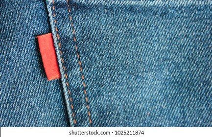 Denim Jeans Empty Red Label Close Up. Casual Vintage Style Jean Clothing Back Side Tag View.