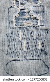 Denim jeans texture or denim jeans background with old torn