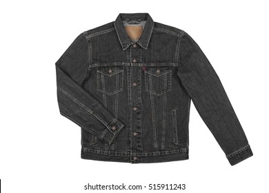 Denim shirt top view on white background with clipping path