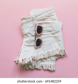 denim shorts with fringe and sunglasses. pink fashion minimalist style