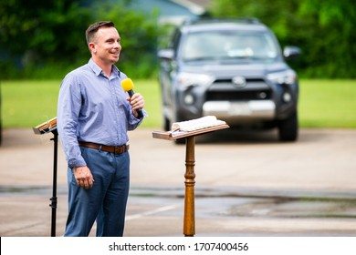 Denison, TX / United States - April 12 2020: A drive-in Easter service led by Pastor Joshua Jackson is held at Mt. Pleasant Missionary Baptist Church in Denison, Texas on April 12, 2020.