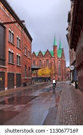 Denmark, Aarhus - October 18, 2014. Ancient street of the 19th century from the red brick and medieval cathedral of Aarhus