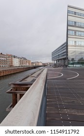 Denmark, Aarhus - October 18, 2014: Bridge over the sea channel at dusk and view of the industrial port in Århus.