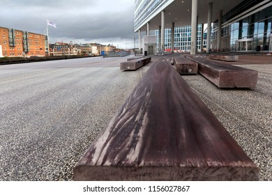 Denmark, Aarhus - October 18, 2014: Bench of timber on the public square in the city of Århus