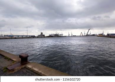 Denmark, Aarhus - October 18, 2014: Marine industrial port of Aarhus in cloudy weather.