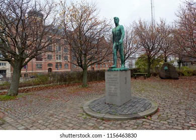 Denmark, Aarhus - October 18, 2014: Monument of 1940-1945 in the city of Aarhus and landscape decoration of the area by hawthorn - autumn and ripe berry.