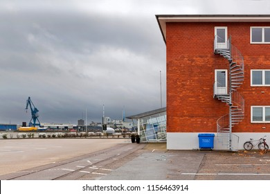 Denmark, Aarhus - October 18, 2014: Red brick building with a spiral staircase in the port of Aarhus
