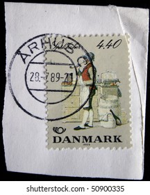 DENMARK - CIRCA 1989: A stamp printed in  Denmark shows Man sells grocery store smoking a pipe, circa 1989