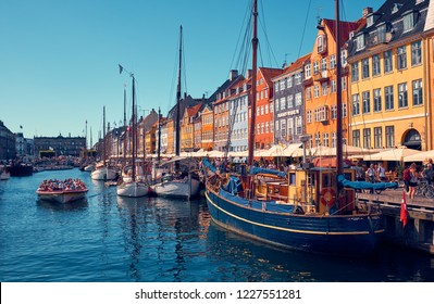 Denmark, Copenhagen - July 2, 2018: Nyhavn is a 17th-century waterfront, canal and entertainment district