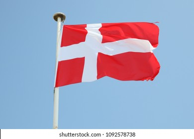 Denmark flag on a mat in the wind and blue sky