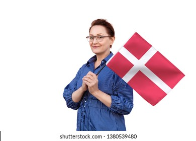 Denmark flag. Woman holding Danish flag. Nice portrait of middle aged lady 40 50 years old holding a large flag isolated on white background.