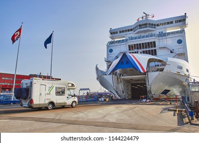 DENMARK, HIRTSHALS- JUNE 05, 2013: Tourist bus rides into the ferry.