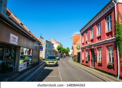 NEXØ, DENMARK - JUNE 30 - 2019: Cars on the streets of danish city Nexø on the island Bornholm