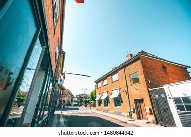 NEXØ, DENMARK - JUNE 30 - 2019: City streets of Nexø downtown on the danish island of Bornholm