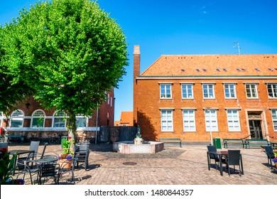 NEXØ, DENMARK - JUNE 30 - 2019: Fountain in the danish city of nexø on the island Bornholm in the summer