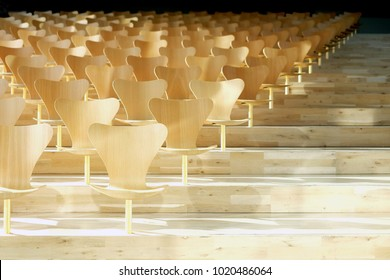 Helsingør, Denmark - October 06, 2017 : A serie of chairs by Fritz Hansen in auditorium space at the Maritime Museum of Denmark by danish architect Bjarke Ingels. (Public Space in Public Building)