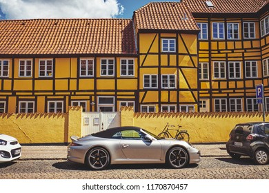 Denmark, Odense - June 30, 2018: modern sports car on the background of an old house