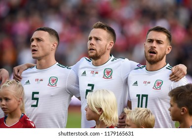 Denmark v Wales, Uefa Nations League, Ceres Park, Aarhus, 9/9/18: Wales' James Chester, Chris Gunter and Aaron Ramsey sing the national anthem