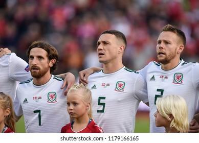 Denmark v Wales, Uefa Nations League, Ceres Park, Aarhus, 9/9/18: Wales' Joe Allen, James Chester and Chris Gunter prepare for the national anthems