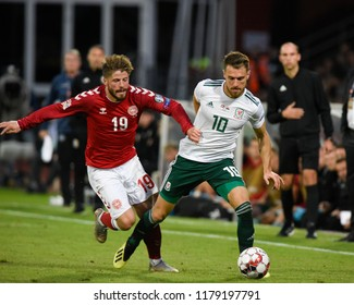 Denmark v Wales, Uefa Nations League, Ceres Park, Aarhus, 9/9/18: Wales' Aaron Ramsey breaks free from denmark midfielder Lasse Schone