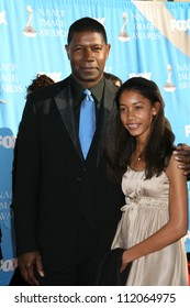Dennis Haysbert and guest at the 38th Annual NAACP Image Awards. Shrine Auditorium, Los Angeles, CA. 03-02-07