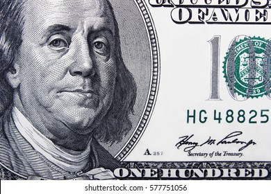 The denomination one hundred dollars bill close-up background