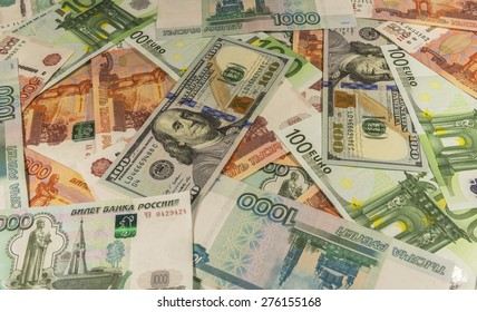 Denominations of 1,000, 5,000 rubles, 100 euros and 100 dollars laid out on the table.