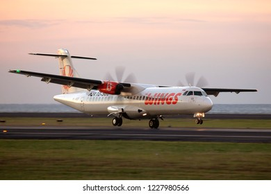 Denpasar, Bali / Indonesia - 03.23.2018. Ngurah Rai International Airport. Passenger aircraft ATR 72 of Wings Airlines (Wings Air) landing during the sunset time.