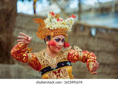 Denpasar, Bali island, Indonesia - June 23, 2016: Portrait of beautiful young Balinese woman in ethnic dancer costume, dancing traditional temple dance.